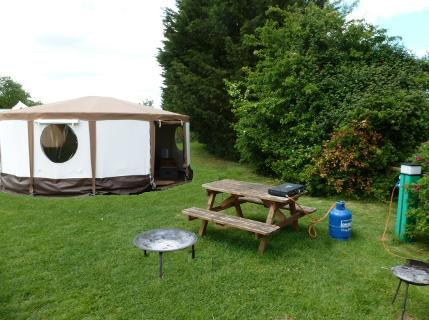 A modern glamping Yurt at Dorset Country Holidays